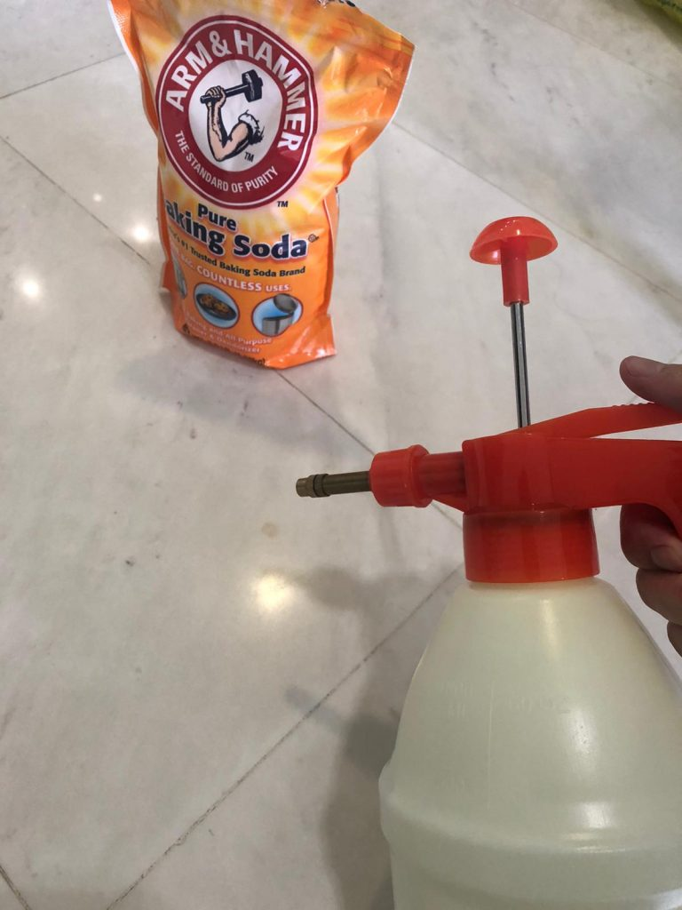 Spraying water on marble floor